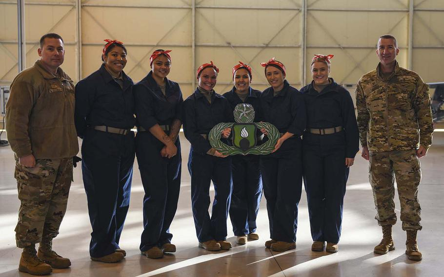 U.S. airmen from the 31st Munitions Squadron and the 731st Munitions Squadron pose with leadership for a photo at Aviano Air Base, Italy, Jan. 7, 2020. The ''Bouncing Bettys'' team had the best score of the teams taking part in Aviano's RAGE competition and will have their names etched on plaques.