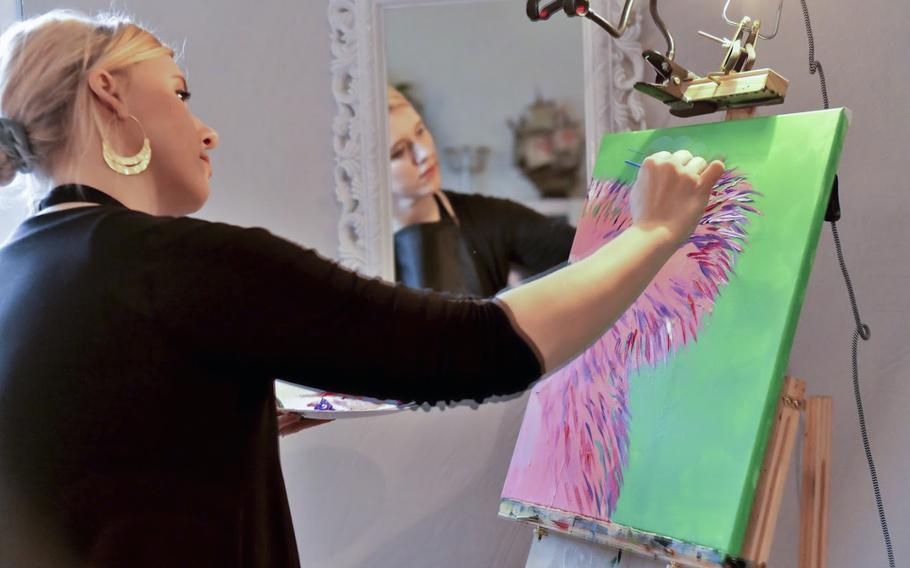 Artist Beatrice Gentry demonstrates to 16 members of the Kaiserslautern military community how to paint a koala, at a fundraiser for victims of the Australian bushfires, in Landstuhl, Germany, on Saturday, Jan. 25, 2020.