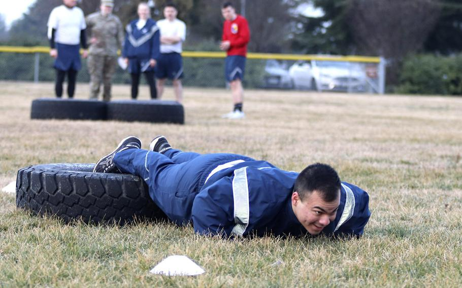 An airman with the 31st Fighter Wing, Aviano Air Base, Italy, performs push-ups during the Amazing Wyvern Race event on Friday, Jan. 31, 2020. The team that tackled various challenges in the fastest time won the event.
