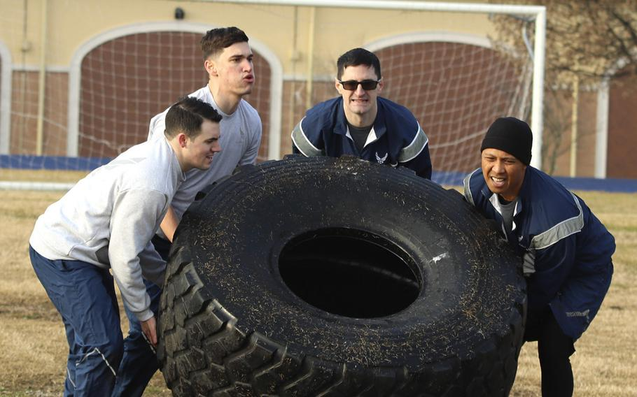 Airmen with the 31st Fighter Wing, Aviano Air Base, Italy, work as a team to tackle one of the challenges in the Amazing Wyvern Race event on Friday, January 31, 2020.