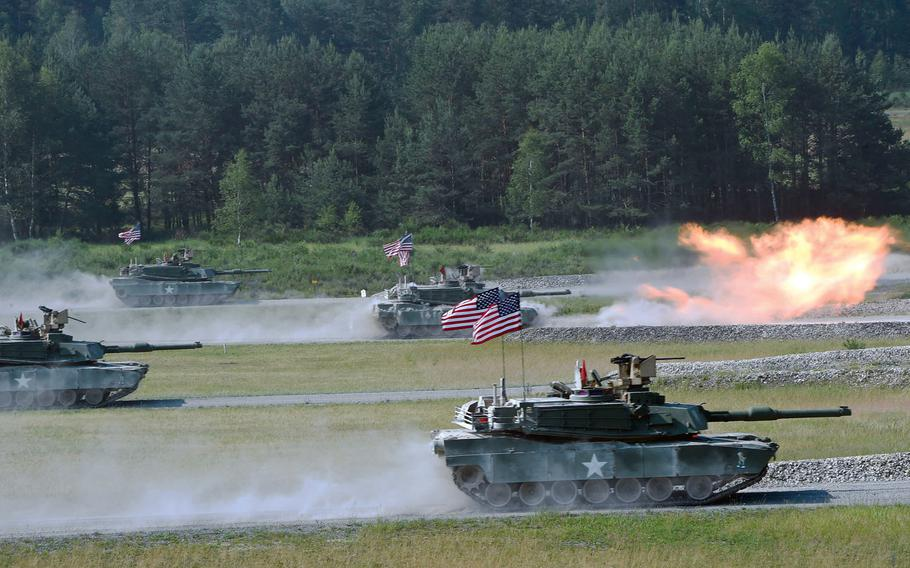 The U.S. tank team fires at targets from its M1A2 Abrams tanks during the Strong Europe Tank Challenge in Grafenwoehr, Germany, in 2018. Heavy ground forces based overseas are the best at deterring conflict, according to a new Rand Corp. study.