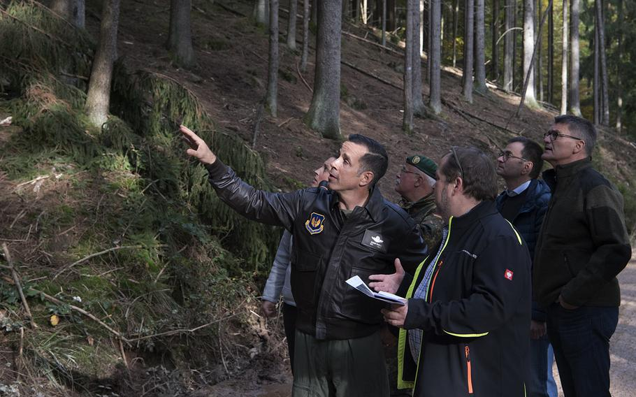 U.S. Air Force Col. Jason Hokaj, 52nd Fighter Wing vice commander, and local German community leaders visit an F-16 Fighting Falcon crash site in Zemmer, Germany, Oct. 25, 2019. The fighter crashed Oct. 8. A partial power failure combined with bad weather caused the jet to crash, the Air Force said Tuesday.