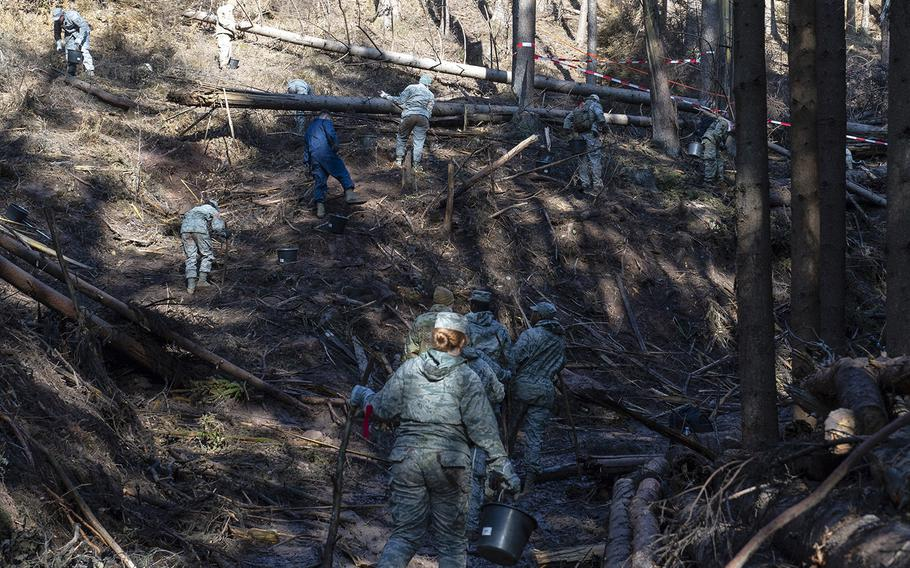 U.S. airmen from the 52nd Fighter Wing scatter across a hillside Oct. 22, 2019, to search and recover wreckage from an F-16 Fighting Falcon that crashed near Zemmer, Germany, Oct. 8, 2019. A partial power failure combined with bad weather caused the jet to crash, the Air Force said Tuesday.