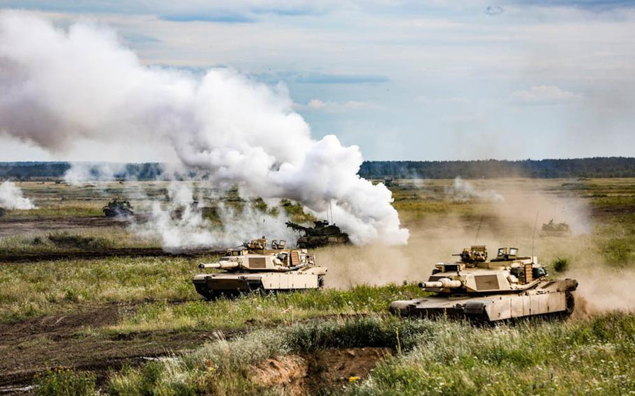 """U.S. and Polish forces participate in a simulated tank battle during the """"Tank Battle"""" event held at  Bemowo Piskie Training Area in Poland, July 13, 2019."""