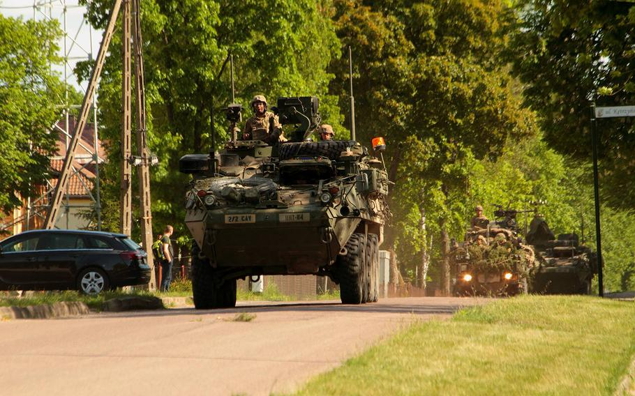 A Stryker armored vehicle leads the way down Ulica Ketrzynskiego, the main street in the small Polish village of Bemowo Piskie, in May 2017.