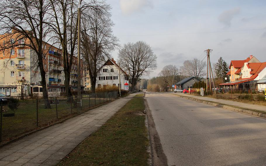 Homes line the main street that runs through Bemowo Piskie, Poland, on Feb. 15, 2020. A U.S.-led NATO battle group is based at the training area on the outskirts of the village in northeastern Poland.