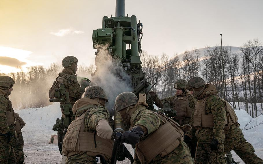 U.S. Marines from 2nd Battalion, 10th Marine Regiment, load a high-explosive round into an M777 Howitzer during a live-fire range near Setermoen, Norway, March 4, 2020.