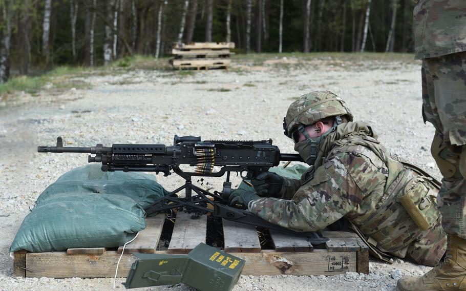 Pfc. Branden Schmidt, an intelligence analyst with the 41st Field Artillery Brigade, fires an M240B machine gun during an exercise at Grafenwoehr Training Area, April 17, 2020.