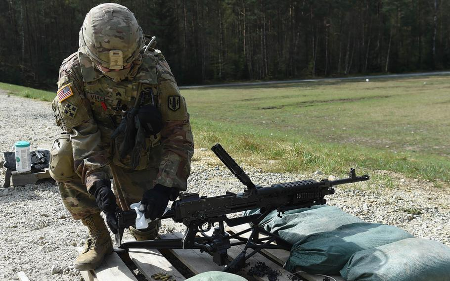 Sgt. Christopher Viall, a wheeled vehicle mechanic with the 41st Field Artillery Brigade, wipes down an M240B machine gun during an exercise at Grafenwoehr Training Area, April 17, 2020.