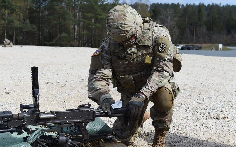 Sgt. Eamonn Dugan, an intelligence analyst with the 41st Field Artillery Brigade, wipes down an M240B machine gun during an exercise at Grafenwoehr Training Area, Germany, April 17, 2020.