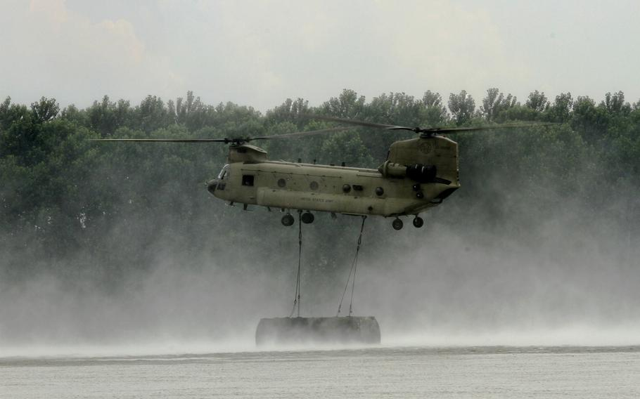 U.S. Army CH-47 Chinook releases a sling load into the Danube River during an exercise in Romania in June 2019. In a report released Tuesday, May 26, 2020, former U.S. Army Europe commander Ben Hodges, who co-authored the report with security analyst Janusz Bugajski, argues for Romania to be center of gravity of NATO's regional deterrence strategy as the alliance shifts its focus to the Black Sea region.