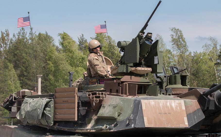In a May, 2016 photo, an American tanker riding a M1A2 SEP Abrams battle tank heads to the firing range as part of the 2016 Strong Europe Tank Challenge held at the Grafenwoehr, Germany, training area.