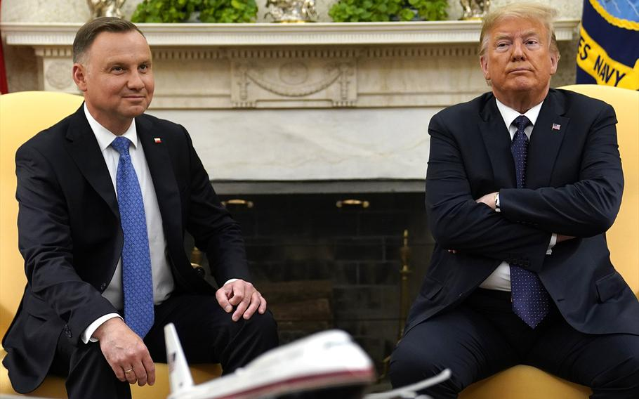 President Donald Trump meets with Polish President Andrzej Duda in the Oval Office of the White House, Wednesday, June 24, 2020, in Washington.