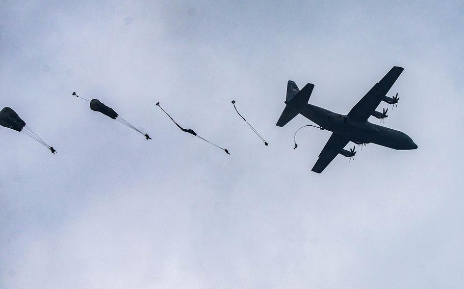 U.S. Army paratroopers from the 173rd Airborne Brigade jump from a C-130 Hercules during an airborne jump at Grafenwoehr Training Area, Germany, June 10, 2020. Six soldiers from the unit were badly injured during a training exercise jump at Grafenwoeh, June 30, 2020. A German fireman was also injured during the rescue.  Christopher Stewart/U.S. Army