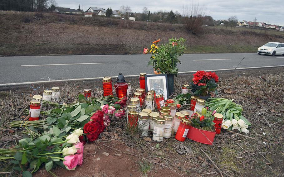 A roadside memorial of flowers and candles was created for a German teenager killed in a car crash with a Ramstein Air Base airman, near Weilerbach, Germany in February 2019.