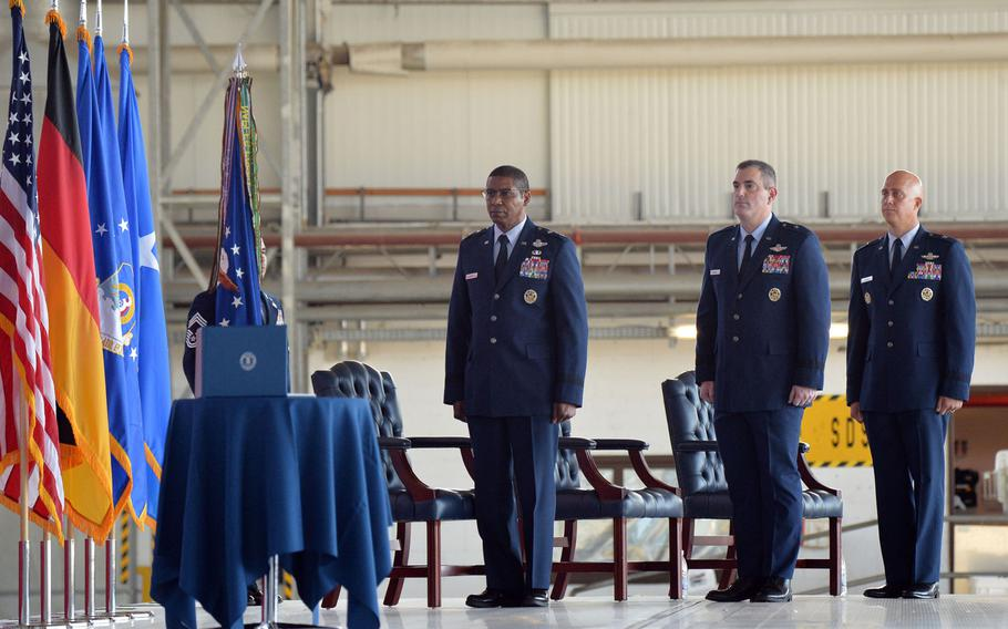 From left, 3rd Air Force commander Maj. Gen. Randall Reed, outgoing commander of the 86th Airlift Wing, Brig. Gen. Mark R. August and the incoming commander Brig. Gen. Joshua M. Olsen stand at the wing's change of command ceremony at Ramstein Air Base, Germany, Aug. 7, 2020.