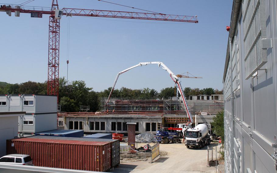 Cranes, concrete mixers and construction crews are at work on a new elementary school at Patch Barracks in Stuttgart, Germany. The base could be forced to close down if the Pentagon puts into action its plan to relocate the U.S. European and Africa commands.