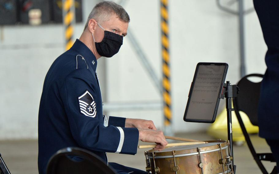 Master Sgt. Timothy Stombaugh, a drummer with the USAFE band, keeps his eye on a bandmate as they entertain before the 86th Airlift Wing change of command ceremony at Ramstein Air Base, Germany, Aug. 7, 2020.