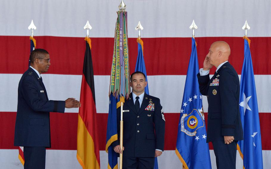 Third Air Force commander Maj. Gen. Randall Reed prepares to return the salute from the new commander of the 86th Airlift Wing, Brig. Gen. Joshua M. Olsen, at the unit's change of command ceremony at Ramstein Air Base, Germany, Aug. 7, 2020. At center is Chief Master Sgt. Tommy Childers with the unit guidon.