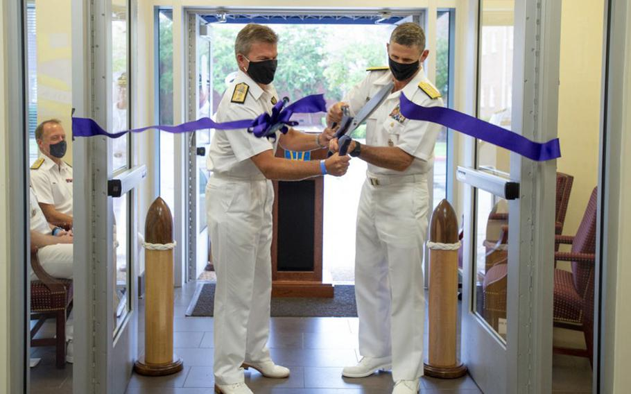 Royal Navy Rear Adm. Andrew Betton, left, and U.S. Vice Adm. Andrew Lewis cut a ribbon at a ceremony at Naval Support Activity, Hampton Roads, Va., Sept. 17, 2020, to mark the start of operations of NATO's new Atlantic Command.  NATO