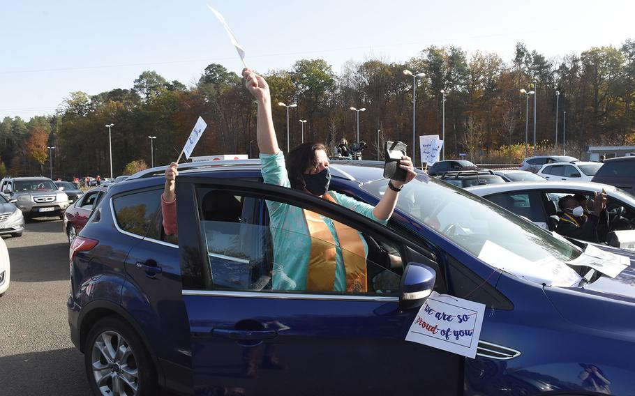 Family and friends cheered from their cars for graduates at the University of Maryland Global Campus Europe commencement ceremony on Saturday, Nov. 7, 2020, in Kaiserslautern, Germany.