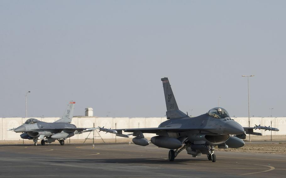 Two U.S. Air Force F-16 Fighting Falcons assigned to the 480th Fighter Squadron, 52nd Fighter Wing, Spangdahlem Air Base, Germany, taxi on the flight line upon arrival at Al Dhafra Air Base, United Arab Emirates, Nov. 12, 2020.