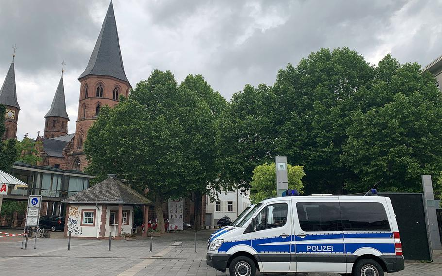 A pair of German police vans are parked in the Stiftsplatz in Kaiserslautern, Germany, in June 2020, ahead of a scheduled demonstration against racism. The U.S. military is warning Americans to stay away from a planned protest in Kaiserslautern on Saturday, Nov.21, against the German government's coronavirus lockdown measures that has the potential to turn violent. Hundreds of police are expected to be on scene.