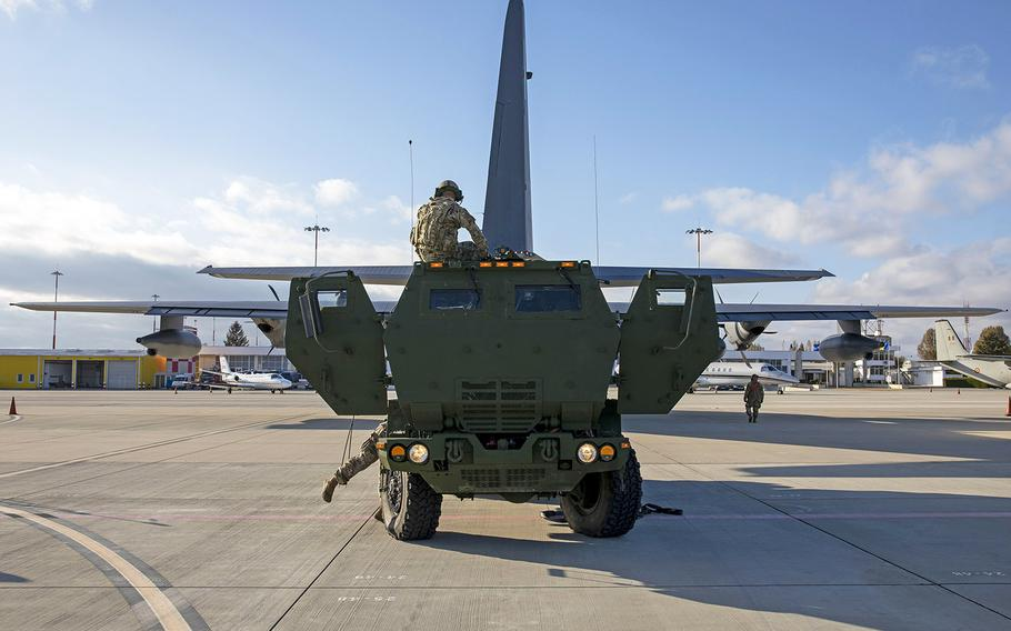 Soldiers assigned to 1st Battalion, 77th Field Artillery Regiment unload High-Mobility Artillery Rocket Systems from 352nd Special Operations Wing's U.S. Air Force MC-130J Commando II as part of exercise Rapid Falcon in Romania, Nov. 19, 2020.