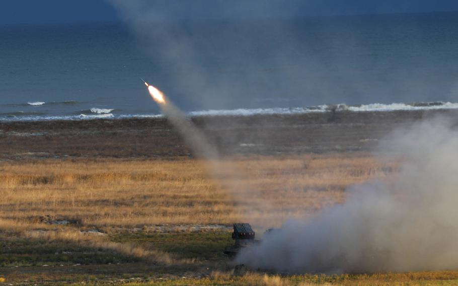A U.S. M142 High Mobility Artillery Rocket System fires its rockets into the Black Sea during Exercise Rapid Falcon Nov. 19, 2020 at Capu Midia, Romania. This was 1st Battalion, 77th Field Artillery Regiment's second live fire event since reactivation just 90 days ago and was the first time U.S. forces, in cooperation with Romanian allies, ever fired HIMARS from land into the Black Sea.
