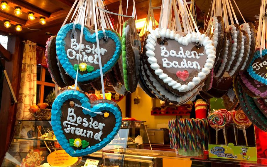 Traditional Christmas cookies hang from a stand at the Christmas market in Baden-Baden, Germany, on Dec. 24, 2019. Germany is partially lifting a travel ban on Americans to allow children whose parents have SOFA status and are assigned to the country to visit during the holidays, but most Christmas markets will be closed because of the coronavirus.