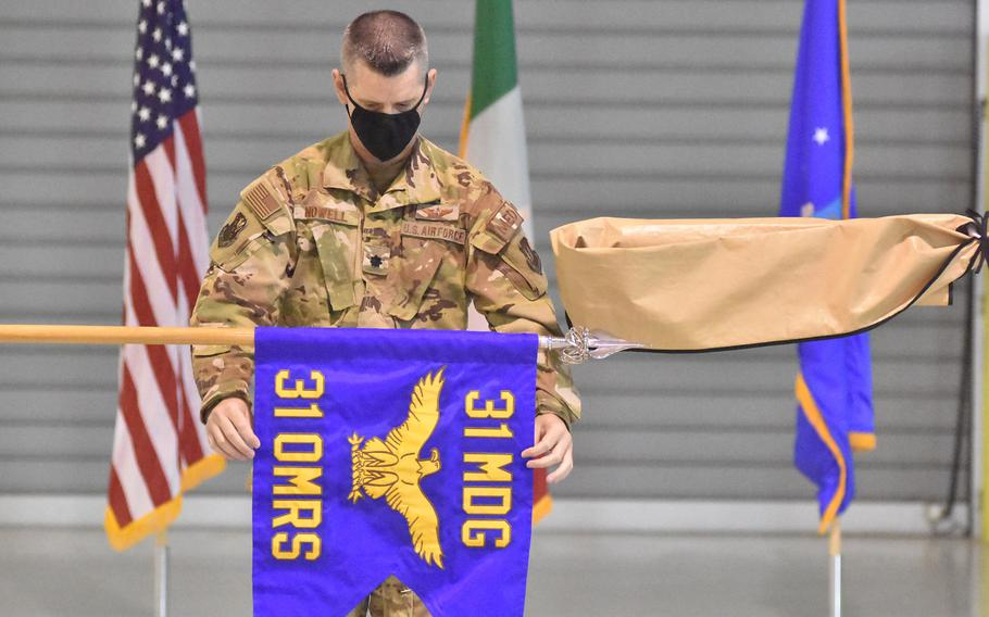 Lt. Col. Clifton Nowell presents the flag of the newly designated 31st Operational Medical Readiness Squadron during a ceremony in October at Aviano Air Base, Italy. The squadron, formerly known as the 31st Aerospace Medical Squadron, will serve the active-duty population on base.