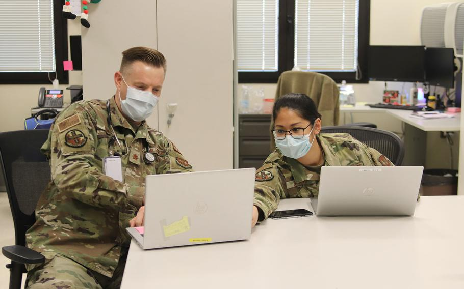 Maj. Jason Hamilton and Capt. Sarah Soriano review records at the newly redesignated Warrior Medical Clinic at Aviano Air Base, Italy. Under a recent change, doctors with the 31st Operational Medical Readiness Squadron are now responsible for care of specific units instead of the general base population.