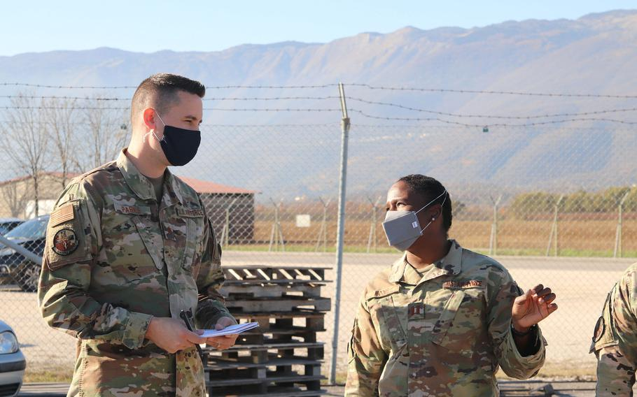 Dr.(Maj.) Ryan Parks, left, and Capt. Laquita Moore talk while observing members of the 31st Logistics Readiness Squadron at work on Thursday, Nov. 20, 2020. Parks and Moore, of the 31st Operational Medical Readiness Squadron, are now responsible for the care of individual units instead of the general base population.