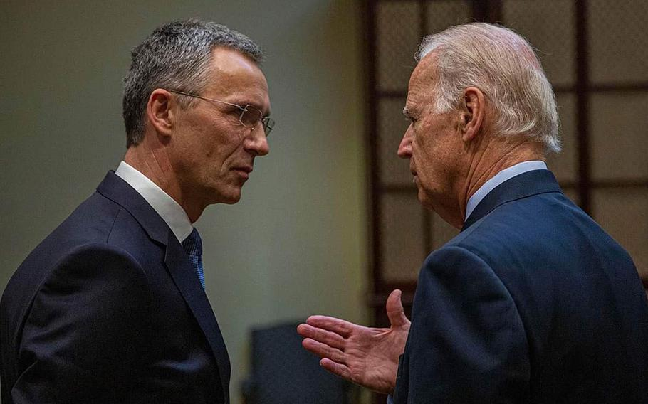 NATO Secretary-General Jens Stoltenberg and and then-U.S. Vice President Joe Biden talk in 2016.