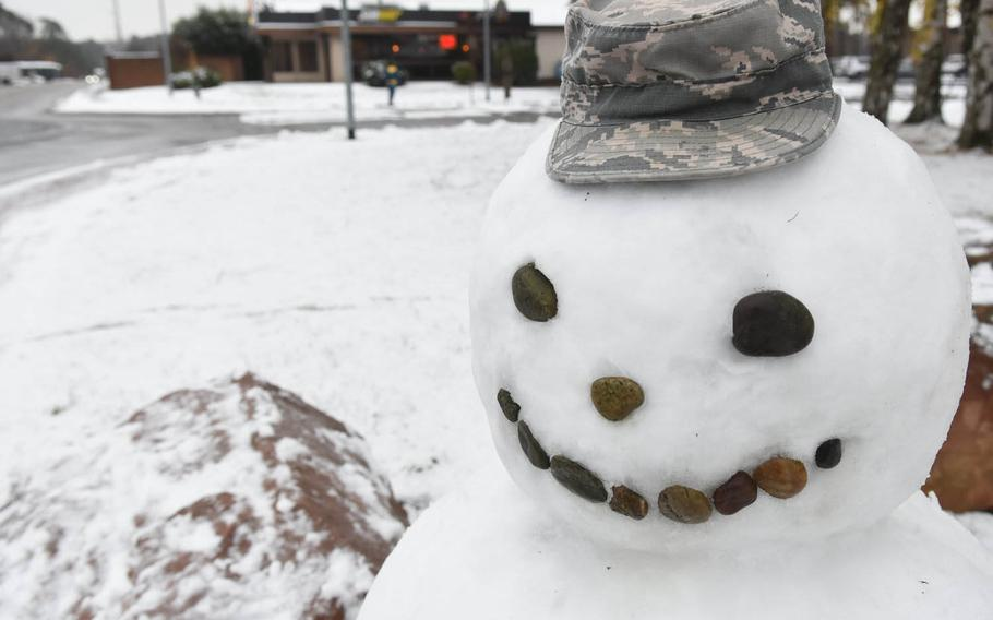 An airman had time to make a snowman decked in a battle dress uniform cap and a face made of rocks on Tuesday, Dec. 1, 2020, at Ramstein Air Base, Germany, as base personnel and the schools had a two-hour reporting delay due to the area's first snowfall of the winter season.