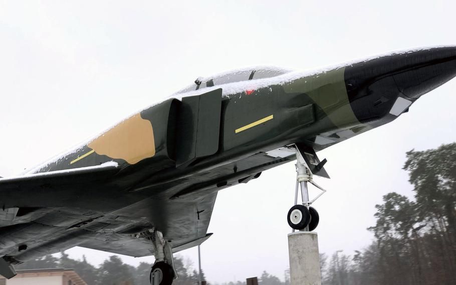 An F-4 Phantom static display on Ramstein Air Base, Germany, is dusted with snow after was the first snowfall of the season for military bases in the Kaiserslautern area, Dec. 1, 2020.