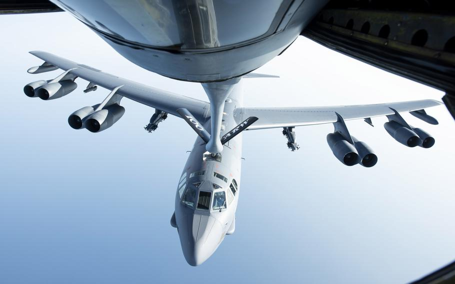 A U.S. Air Force B-52H Stratofortress, of the 5th Bomb Wing at Minot Air Force Base, N.D., flies below a KC-135 Stratotanker from the 100th Air Refueling Wing, RAF Mildenhall, England, after receiving fuel during a mission in September 2020. B-52s flew in a show of force mission over the Barents Sea Dec. 3, but one plane had to be diverted because of safety problems.