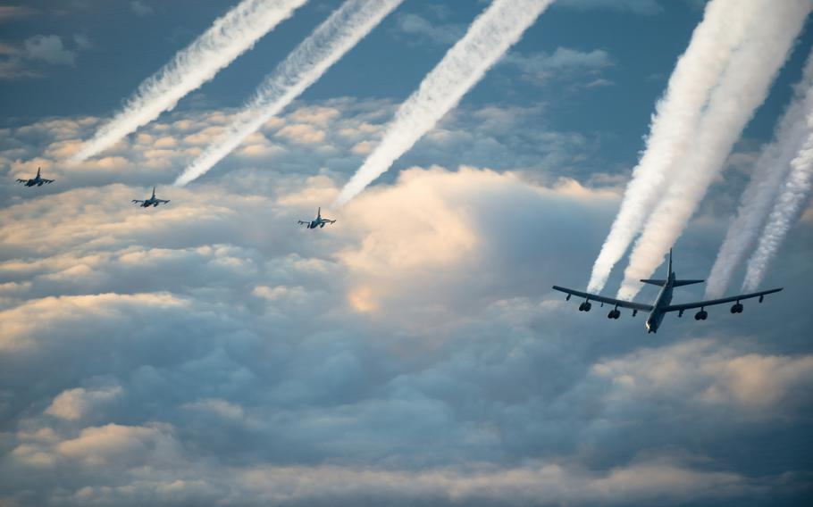 A U.S. Air Force B-52H Stratofortress and three Norwegian air force F-16 Fighting Falcons fly together toward the Barents Sea region in November 2019. B-52s flew in a show of force mission over the Barents Sea on Dec. 3, 2020, but one plane had to be diverted because of safety problems.