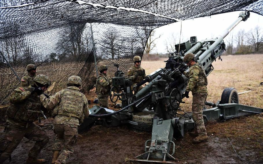 Soldiers with the Army's 2nd Cavalry Regiment demonstrate how to fire an M777 Howitzer, during an exercise in March 2019. U.S lawmakers are halting a Pentagon plan to remove 12,000 troops from Germany, according to a new defense bill. The regiment was one of the units slated to leave under the proposal.