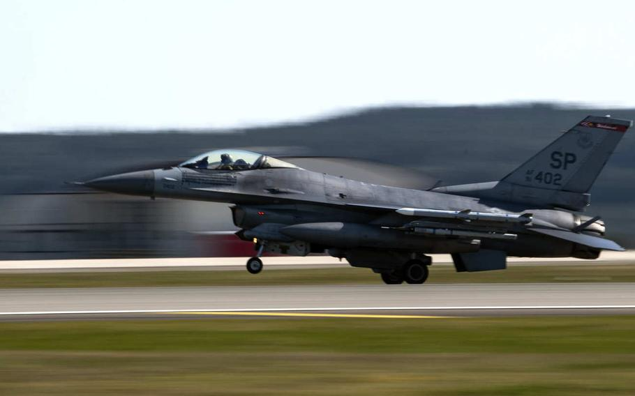 A U.S. Air Force F-16 Fighting Falcon of the 480th Fighter Squadron lands at Spangdahlem Air Base, Germany, in March 2020. The latest defense bill would halt a Pentagon plan to remove 12,000 troops from Germany. The base's F-16s were to be moved to Italy under the Pentagon plan.