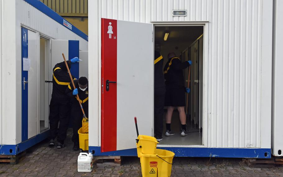 Soldiers at the Task Force Willkommen quarantine facilities on Rhine Ordnance Barracks in Kaiserslautern, Germany, clean their field latrines and showers, Nov. 12, 2020, a daily chore the soldiers perform during their two weeks of restricted movement before moving on to their units.