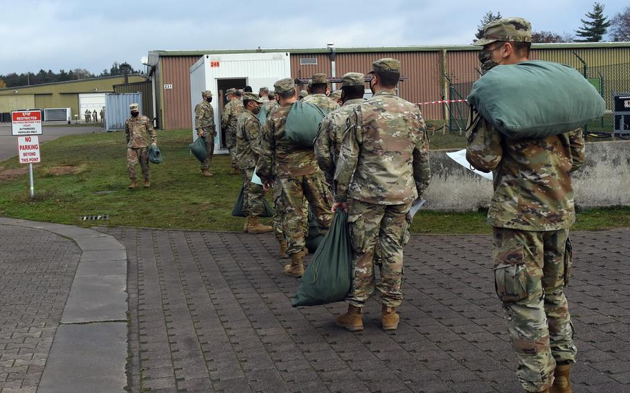 Soldiers at the Task Force Willkommen quarantine facilities on Rhine Ordnance Barracks in Kaiserslautern, Germany, wait in line to drop off their laundry, Nov. 12, 2020.