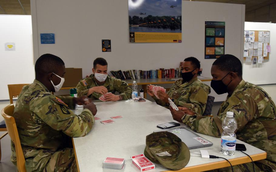 Soldiers play a game of cards Nov. 12, 2020, while under quarantine for 14 days at Rhine Ordnance Barracks in Kaiserslautern, Germany. Unaccompanied, junior enlisted soldiers moving to Germany or transiting through the country on the way to a deployment in Europe quarantine at the facility for two weeks until cleared to go to their units or destination, a process aimed at stopping the spread of the coronavirus.