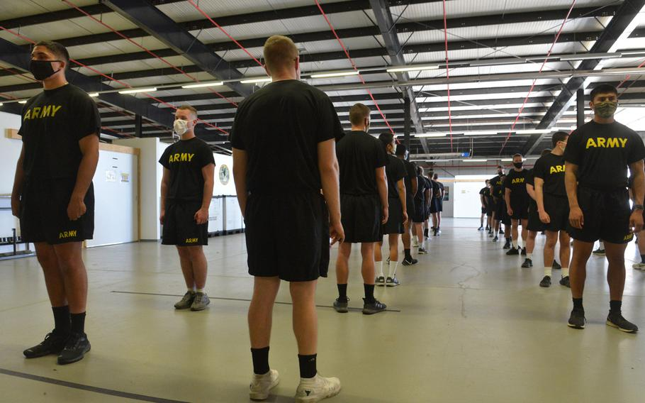 Soldiers line up to get a coronavirus test on the 10th day in isolation at the quarantine center at Task Force Willkommen quarantine facilities on Rhine Ordnance Barracks in Kaiserslautern, Germany, in September 2020.