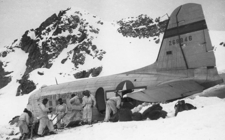 The operation to rescue the passengers and crew of a U.S. C-53 Skytrooper is underway at the top of the Gauli Glacier in Switzerland, where the plane crash-landed in Nov. 1946. Analysis of ice samples collected from the glacier in 2019  led a scientist to update predictions of where and when the plane's fuselage will emerge from the ice.