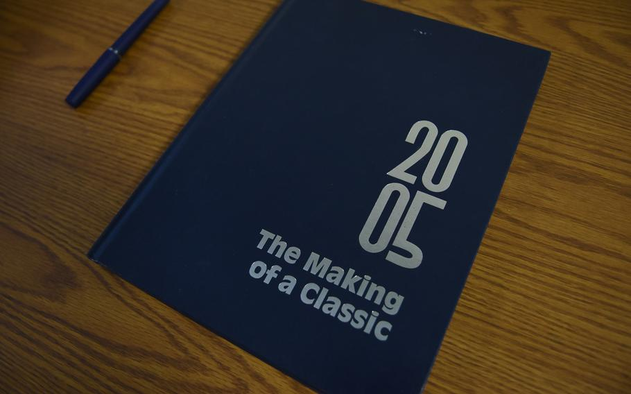 A yearbook from the class of 2005 sat on a table inside senior hall at Ramstein High School at Ramstein Air Base, Germany. The school's senior class officers found the same yearbook covered in dust in the time capsule they opened on Friday, Dec. 11, 2020, left by the class of 2005.