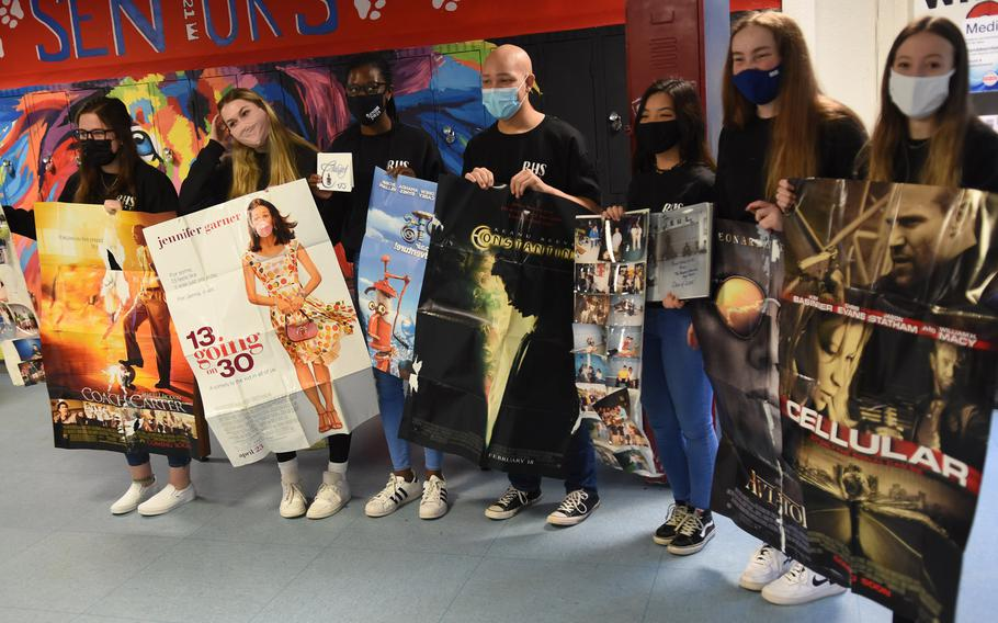 Ramstein High School senior class officers hold up old movie posters left in a time capsule by the class of 2005. The seniors opened the capsule, a padlocked school locker, on Friday, Dec. 11, 2020.