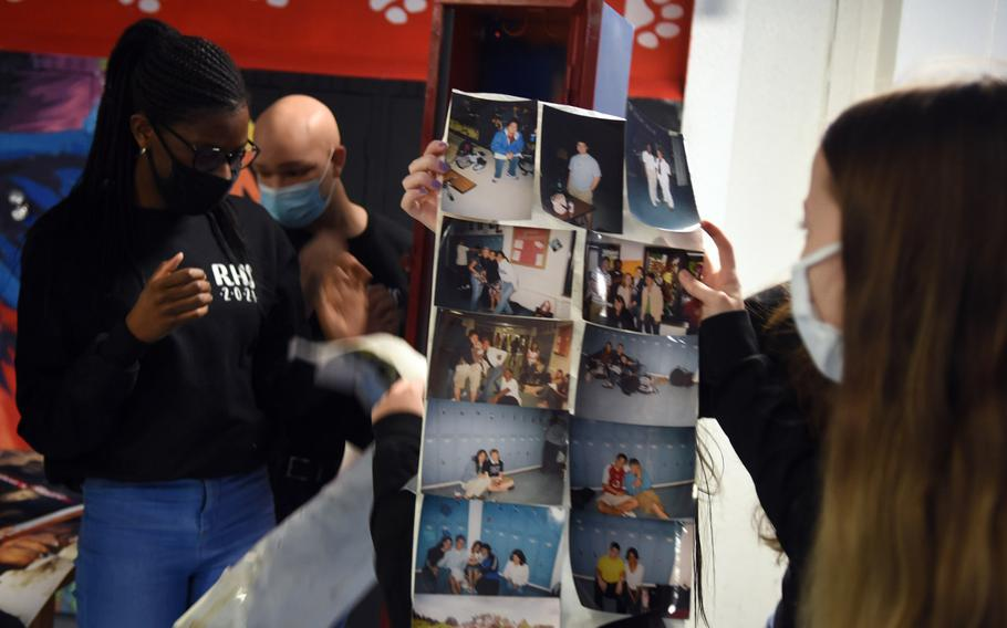 Ramstein High School seniors look over old photos left in a time capsule by the class of 2005, on Dec. 11, 2020. The students wore baggier, more comfortable-looking clothes, this year's seniors noticed, and boot-cut jeans and skirts were in, they observed.