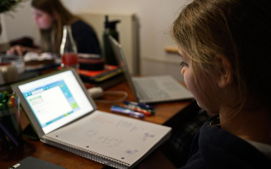 Kendal Morgenweck, a student at Hohenfels Elementary School, Germany, does her daily online assignments at home in March 2020, during the first coronavirus lockdown.  Department of Defense Education Activity schools in Germany will hold their final in-person classes Dec. 15, 2020, before switching to remote learning following the winter break.