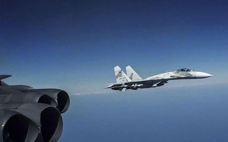 A Russian Su-27 Flanker jet flies alongside a U.S. Air Force B-52 bomber conducting operations over Black Sea international waters, Aug. 28, 2020. About 90% of the more than 400 NATO warplane scrambles in 2020 were connected to Russian military aircraft, marking a slight increase from 2019, the alliance says.  Capture from U.S. Air Force video